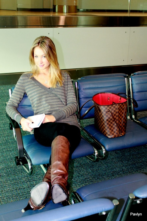 Waiting for our flight - so comfy in a striped sweater and tights!
