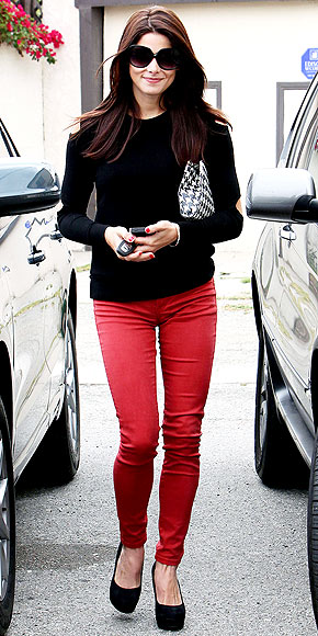 Ashley Green in Bright Red J brand jeans and a black sweater