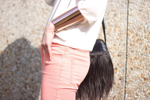 Pink skinny jeans with white top