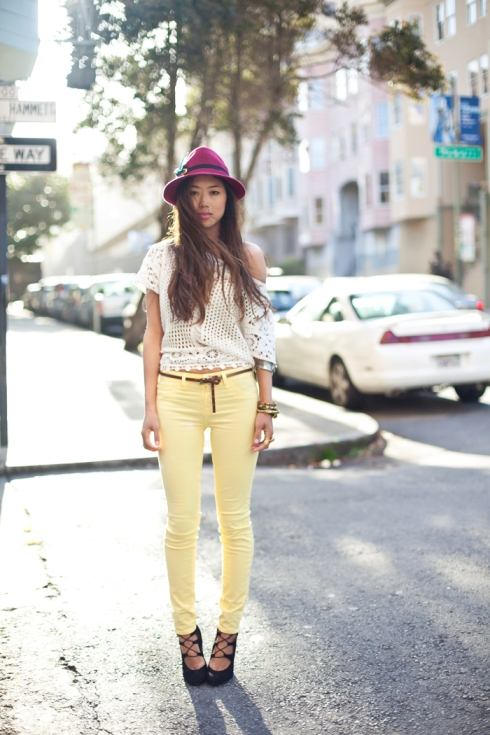 Pairing a Canard yellow J Brand pair of jeans with a white top