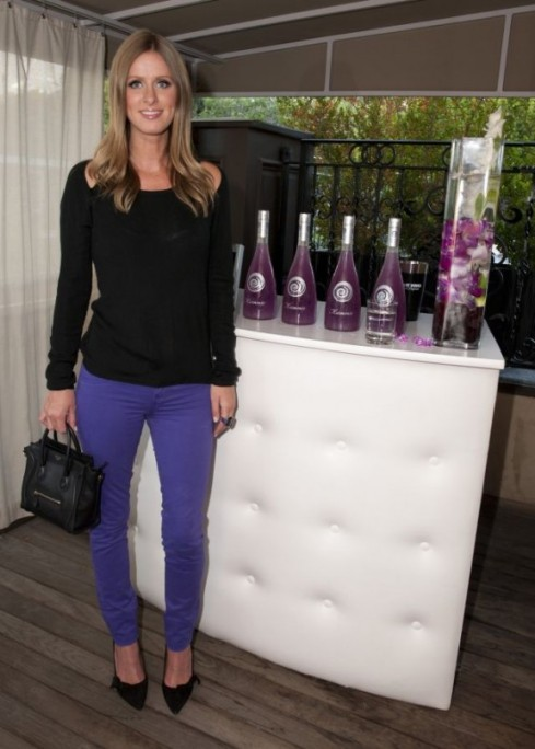 Nicky Hilton in Bright Purple J Brand 811 mid rise skinny jeans