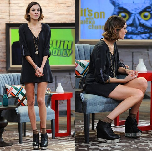 Alexa Chung wearing black lace up wedge booties