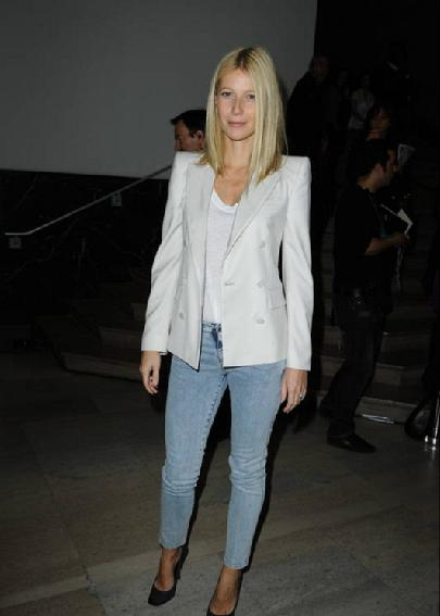 Gwyneth Paltrow wearing light blue jeans and white blazer