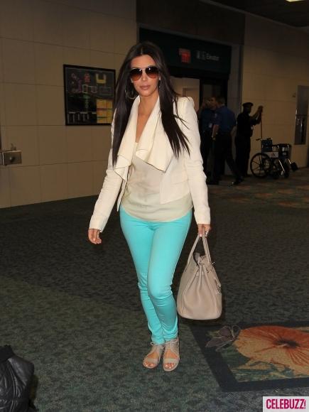 Kim Kardashian in Bright Aqua Skinny Jeans