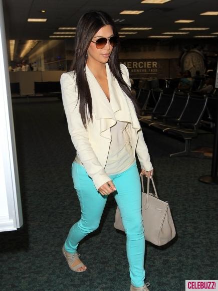 Kim Kardashian in turquoise blue jeans Florida airport