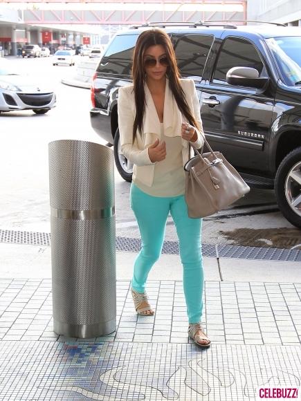 Kim Kardashian in neon blue skinny jeans