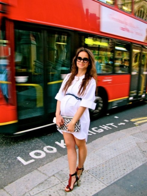 Miroslava Duma pregnant in white dress