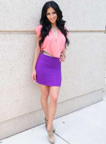 Nicole Scherzinger colour blocking in purple skirt and pink top