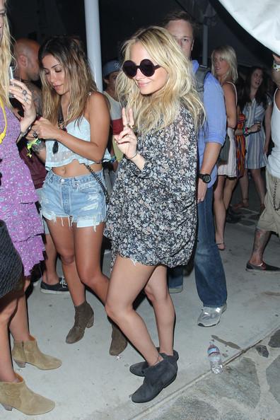 Nicole Richie wearing a chiffon tunic and round sunnies at Coachella festival
