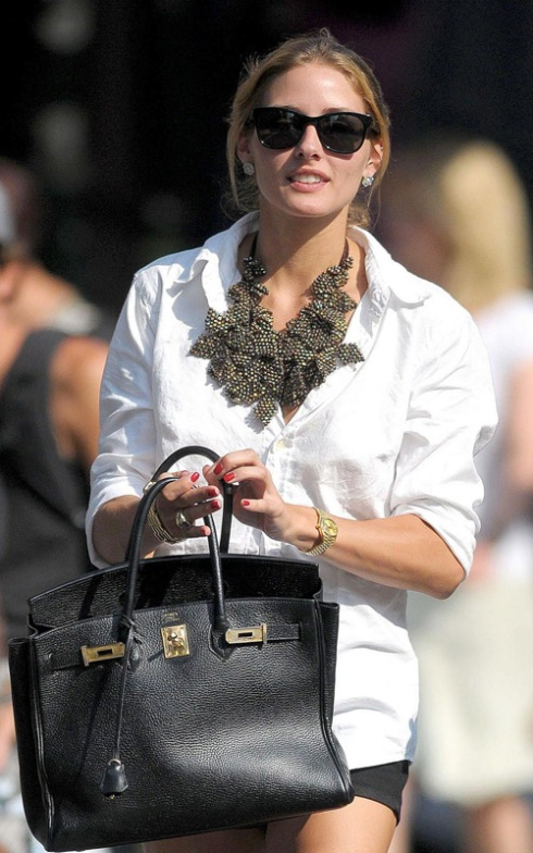 Olivia Palermo in white blouse and statement necklace