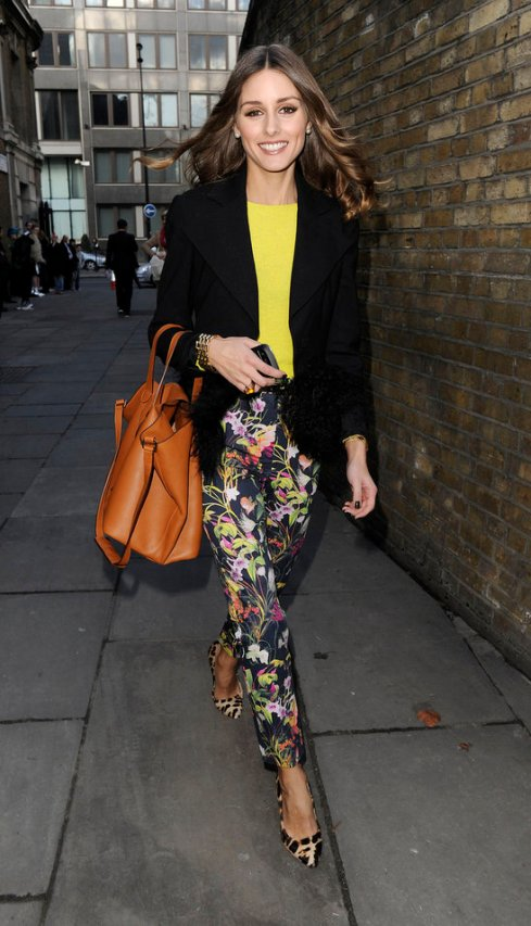 Olivia Palermo wearing black floral pants from Topshop