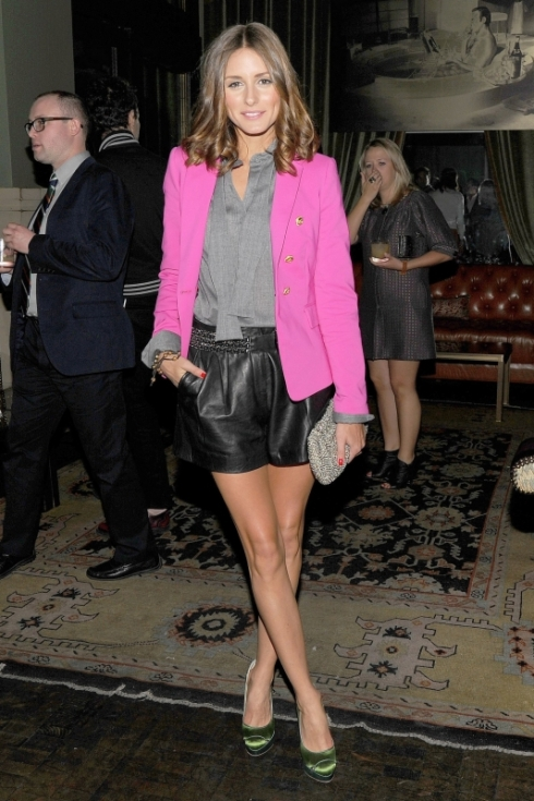 Olivia Palermo in hot pink blazer with leather shorts