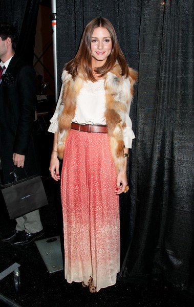 Olivia Palermo wearing maxi skirt with fur vest