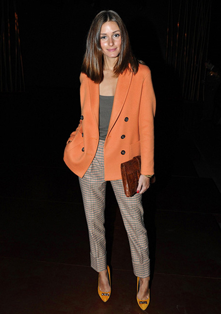 Olivia Palermo wearing orange double breasted blazer