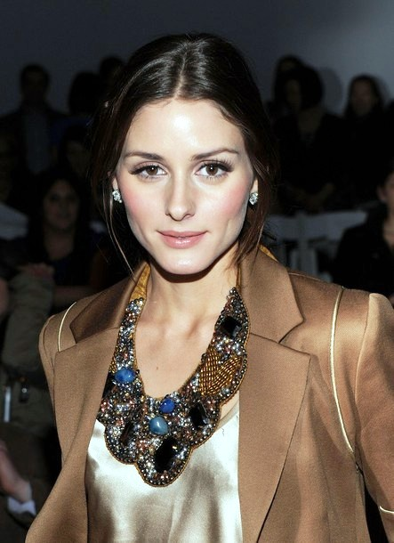 Olivia Palermo wearing statement necklace and gold blazer