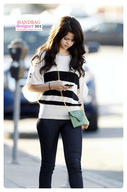 Selena Gomez wearing chain envelope croco clutch