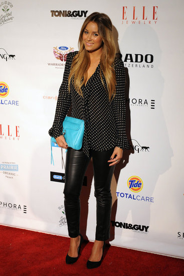 Lauren Conrad wearing black leather pants with Rebecca Minkoff MAC clutch