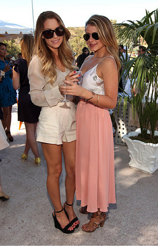 Lauren Conrad in white shorts and beige blouse