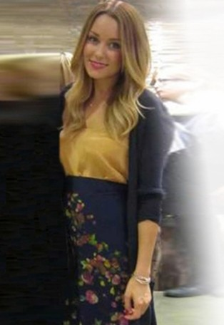 Lauren Conrad in navy floral print maxi skirt by Paper Crown