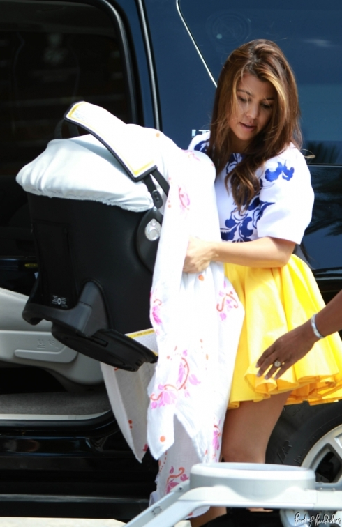 Kourtney Kardashian in Blaque Label Yellow Skirt