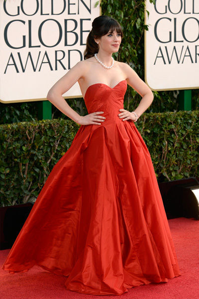 Zooey Deschanel at the Golden Globes in a red OscardelaRenta
